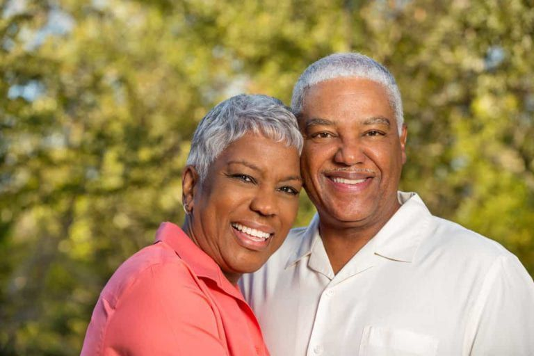Man and woman smiling outside
